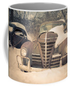Old Plymouth Classic Car In The Snow Coffee Mug by Edward Fielding