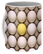 One Yellow Egg With White Eggs Coffee Mug