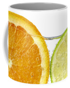 Orange And Lime Slices In Water Coffee Mug by Elena Elisseeva