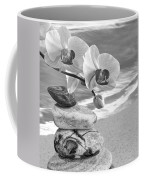 Orchids And Pebbles On The Sand In Black And White Coffee Mug