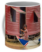 Paddling Through The Village Coffee Mug