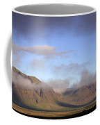 Panoramic View Of The Mountains Lit By The Sun Coffee Mug