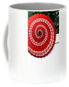 Paper Umbrella With Swirl Pattern On Fence Coffee Mug