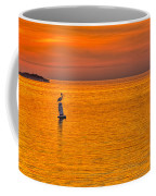 Pelican On A Buoy Coffee Mug by Marvin Spates