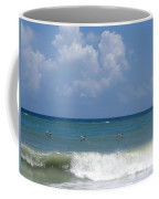 Pelicans Over The Ocean Coffee Mug