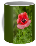 Pink Poppy Flower Among The Green Background Coffee Mug