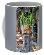 Plant And Table Top Rests On Mannequin Coffee Mug