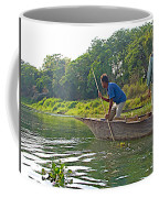 Poling A Dugout Canoe In The Rapti River In Chitwan National Park-nepal Coffee Mug