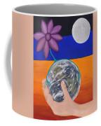Pondering Creation Hand And Globe Coffee Mug