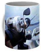 Portrait  Of Fishing Reel On Boat While Coffee Mug
