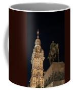 Public Statue And Skyscraper At Night Coffee Mug
