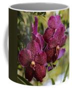 Purple Orchids With Bokeh Coffee Mug