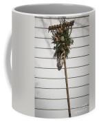 Rake And Wreath Coffee Mug