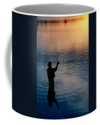 Rear View Of Fly-fisherman Silhouetted Coffee Mug