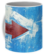Red Arrow Painted On Blue Wall Coffee Mug