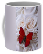 Red Butterfly Among White Roses Coffee Mug