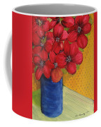 Red Flowers In A Blue Vase Coffee Mug