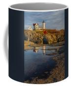 Reflecting On Nubble Lighthouse Coffee Mug by Susan Candelario