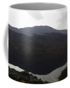 Reflection Of Hills In A Loch In The Scottish Highlands Coffee Mug