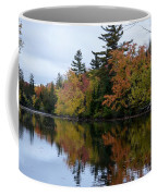 Reflection On The Raquette River Coffee Mug