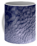 Ripples In The Dark Blue Sky Coffee Mug