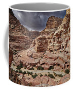 rock landscape with simple tombs in Petra Coffee Mug