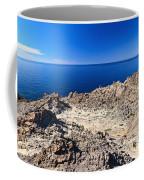 rocky coast in San Pietro island Coffee Mug