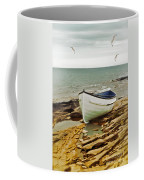 Row Boat On Rocky Shore Coffee Mug
