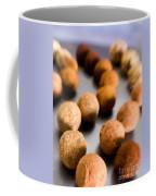 Rows Of Chocolate Truffles On Silver Coffee Mug