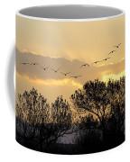 Sandhill Cranes Flying At Sunset Coffee Mug