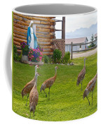 Sandhill Cranes On The Lawn By The Statue Of Mary In Homer-alaska Coffee Mug