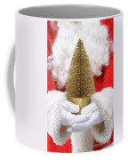 Santa Claus Holding Christmas Tree Coffee Mug