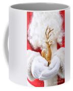 Santa Holding Reindeer Figure Coffee Mug