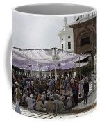 Seated Devotees Inside The Golden Temple Coffee Mug