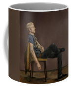 Seated Man Coffee Mug