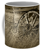 Sepia Toned Photo Of An Old Broken Wheel Of A Farm Wagon Coffee Mug