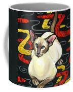 Siamese Cat On A Cushion Coffee Mug