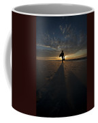 Silhouette Of A Man Wearing Hat And The Bag In Hand Walking On The Seashore Coffee Mug