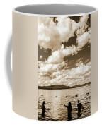 Silhouette Of People Standing In Lake Coffee Mug