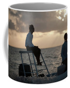 Sillouetted Man Steers Flats Boat Coffee Mug