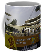 Singapore Flyer Along With The Sight-seeing Bus That Takes Tourists Around The City Coffee Mug