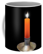 Single Orange Candle On Black Coffee Mug