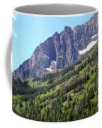 Sloping Mountain At Two Medicine Lake Coffee Mug by Carol Groenen