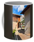 small street in Penia Coffee Mug