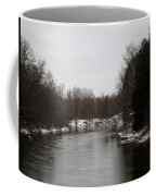 Snow On The Manistee River Coffee Mug