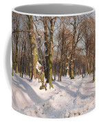 Snowy Forest Road In Sunlight Coffee Mug