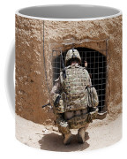 Soldier Searches A Compound Coffee Mug by Stocktrek Images
