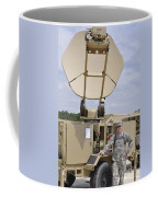 Soldier Stands Next To A Satellite Coffee Mug