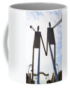South Street Stick Men Statue Coffee Mug