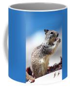 Squirrel Enjoying Lunch On The Beach Coffee Mug